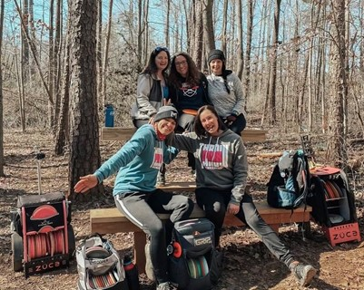 Katie hudgens and her friends playing disc golf