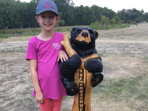 Hayden posing with wooden bear at The Preserve DGC